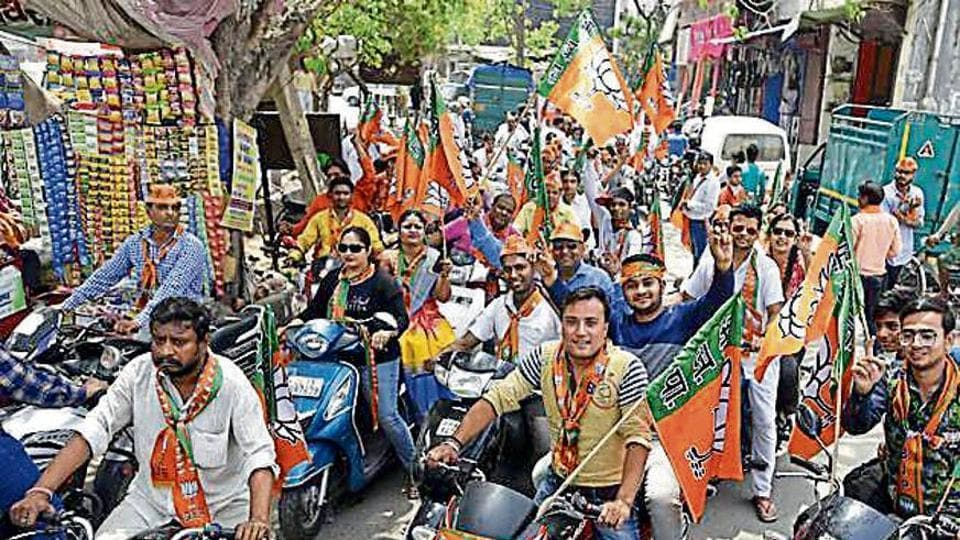 BJP workers during a bike rally on the last day of campaigning for the MCD elections in east Delhi on Friday.