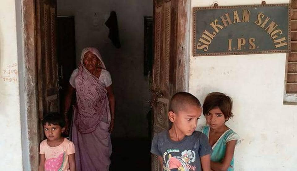 Uttar Pradesh DGP Sulkhan Singh's mother,  nephew and nieces  at his ancestral home in Jauharpur village in Banda district.
