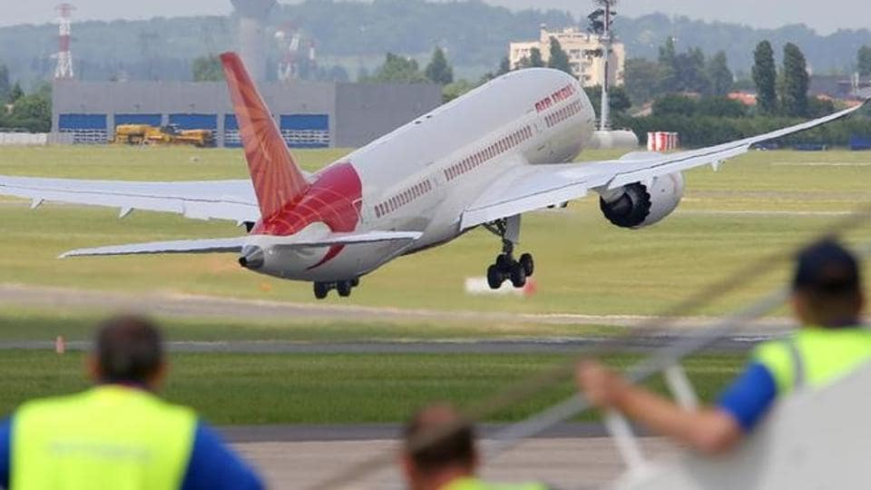 An Air India airlines taking off from the runway.