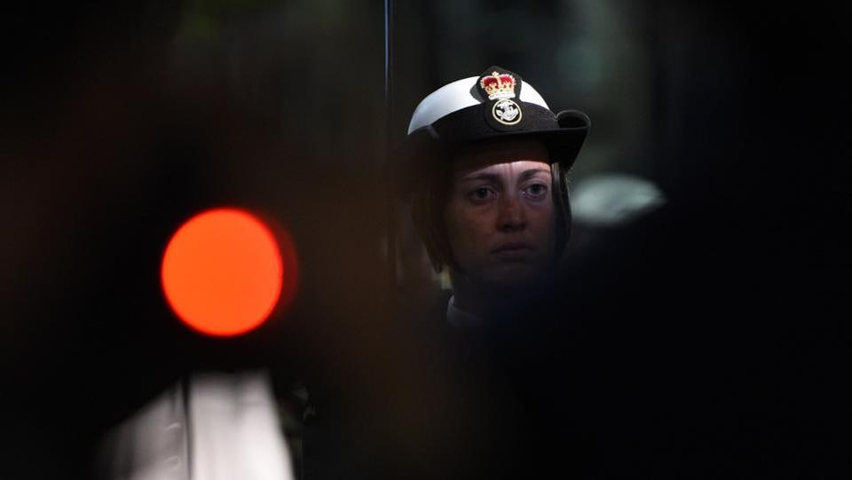 A servicewoman observes a minute of silence at the Dawn Service of Anzac Day in Sydney. (Saeed Khan/AFP)