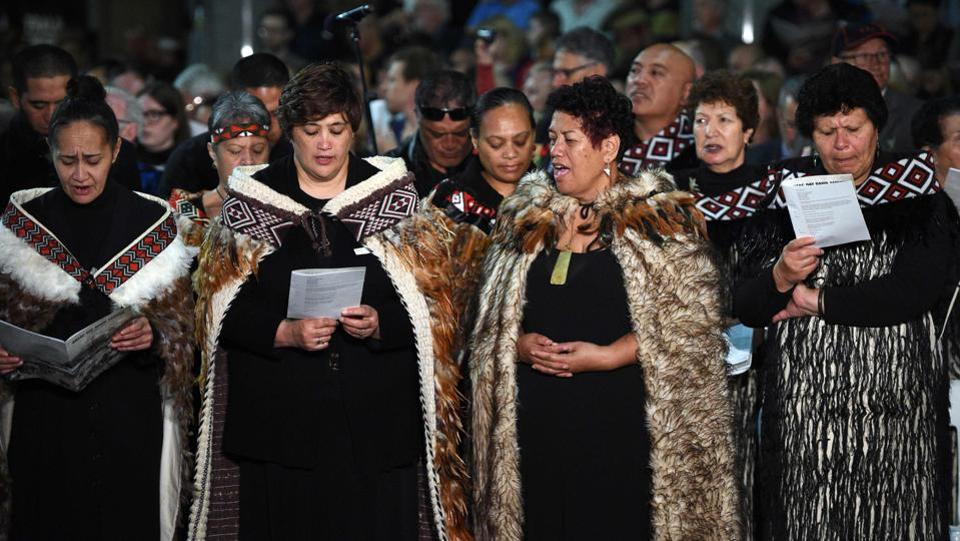 Te Wairua Tapu Choir from New Zealand sing 'Song of Sorrow', in Maori language, during the Anzac Day Dawn Service in Sydney. (Saeed Khan/AFP)