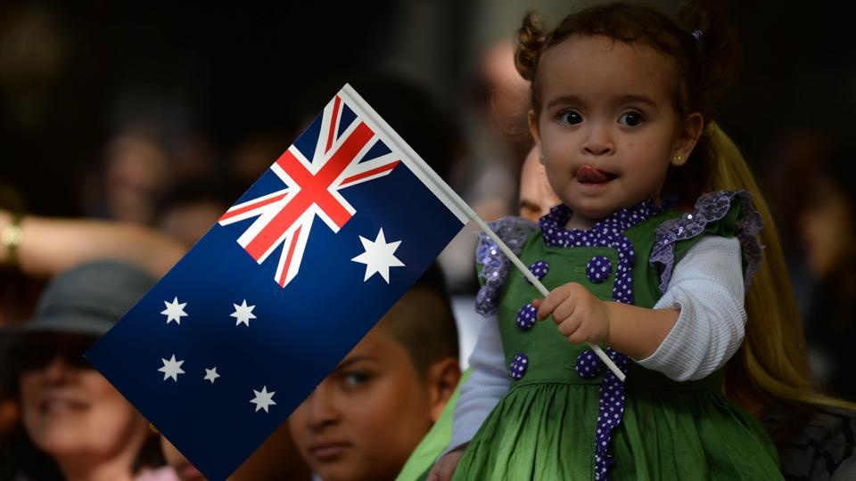 A young girl waves the Australian flag as she watches the Anzac Day parade in Sydney. Australian Prime Minister Malcolm Turnbull posted a message and photo on Twitter on Tuesday after his unannounced visit to Australian troops in Afghanistan and Iraq this week. (Peter Parks/AFP)