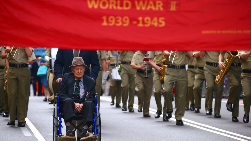 A veteran sits in a wheelchair as he participates in the annual ANZAC Day march. In Canberra, indigenous veterans -- who had to fight to be recognised for their sacrifices -- led the national march for the first time. (David Gray/REUTERS)