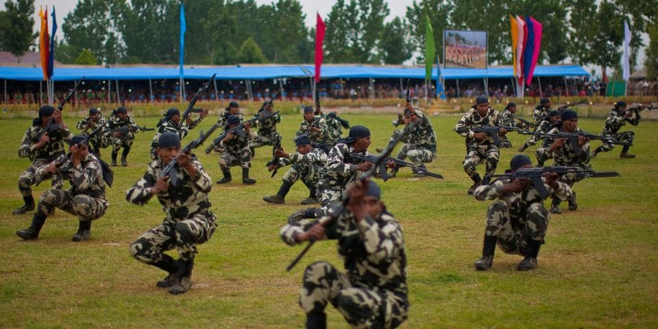 Commandos of Central Reserve Police Force show their skills after their graduation ceremony on the outskirts of Srinagar.
