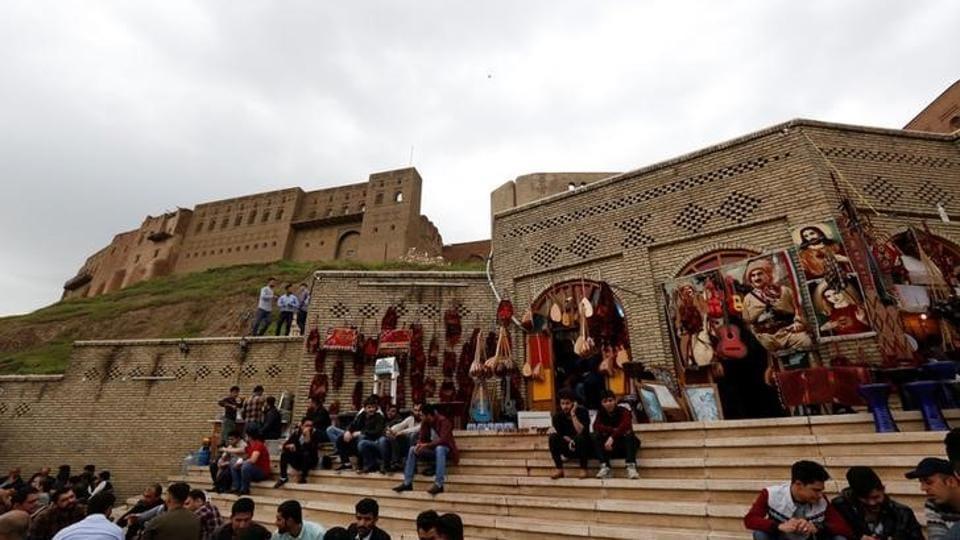 Kurdish people sit in a coffee shop in front of Erbil Citadel, Iraq April 14, 2017.