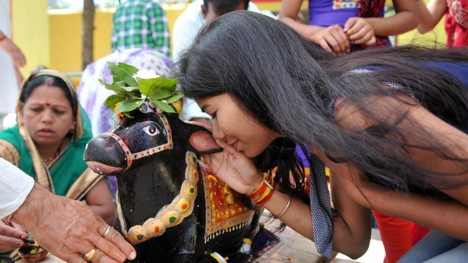 A young girl and other devotees offer prayers at the Pashupatinath temple in Bhopal on Mahashivratri.