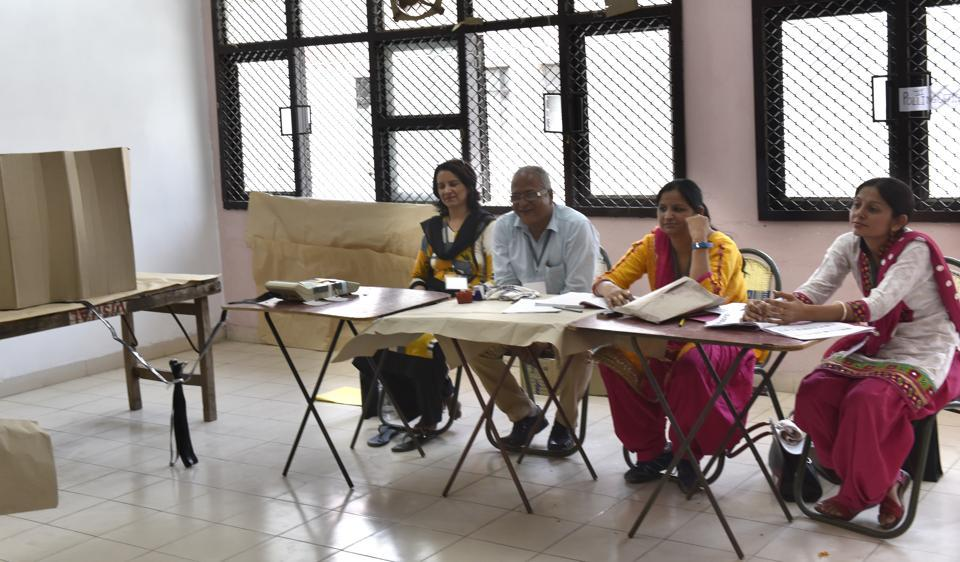 MCD election staff waiting for voters at a poll booth in Old Delhi.