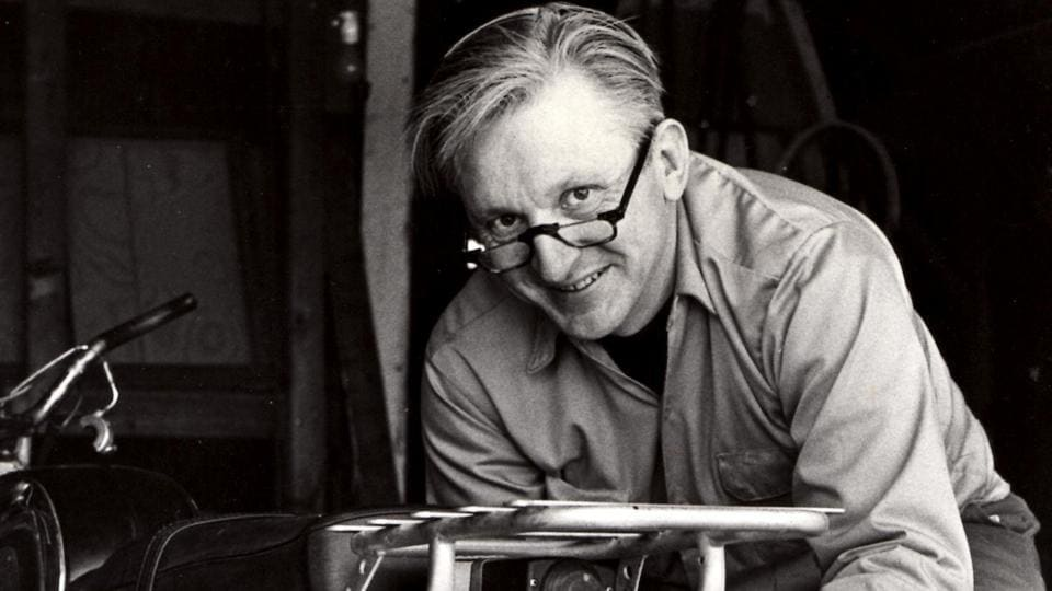 This 1975 image released by William Morrow shows author Robert M Pirsig working on a motorcycle.