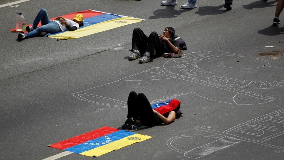 Opposition supporters attend a rally against Venezuela's President Nicolas Maduro. The return to violence in the streets of Venezuela after a weekend lull was certain to further stoke international concern over the country, whose economy is imploding despite vast oil reserves. (Christian Veron/REUTERS)