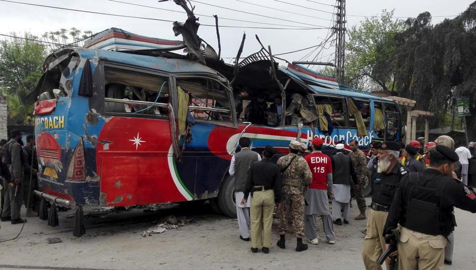 A remote-controlled roadside bomb targeting a minibus killed at least 10 people and wounded several others in Pakistan's northwestern tribal region bordering Afghanistan on Tuesday.