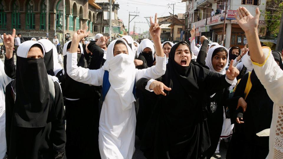 Girl students shout slogans during a protest rally against the recent police action on students in Srinagar.  PDP's candidate for Anantnag Lok Sabha by-poll has asked  the Election Commission to indefinitely defer the election that has once been postponed to May 25.