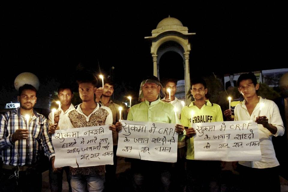 People take part in a candlelight vigil to pray for CRPF soldiers who died in a Maoist attack in Chhattisgarh's Sukma district, in Patna on Monday.
