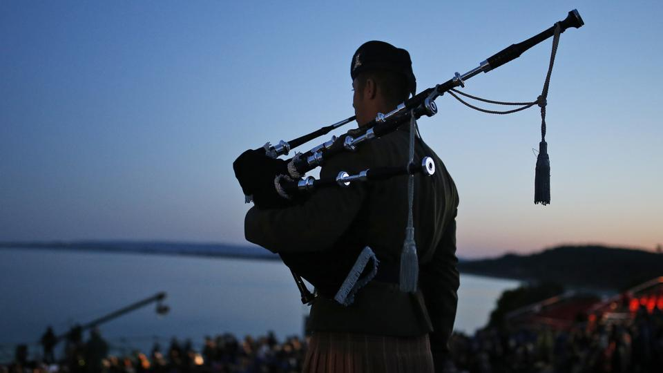 A bagpiper performs during the Dawn Service ceremony at the Anzac Cove beach in Gallipoli peninsula, in Turkey. Television footage showed veterans and their families marching by flag-waving crowds and laying wreaths at war memorials in Sydney and other Australian cities. (Emrah Gurel/AP)