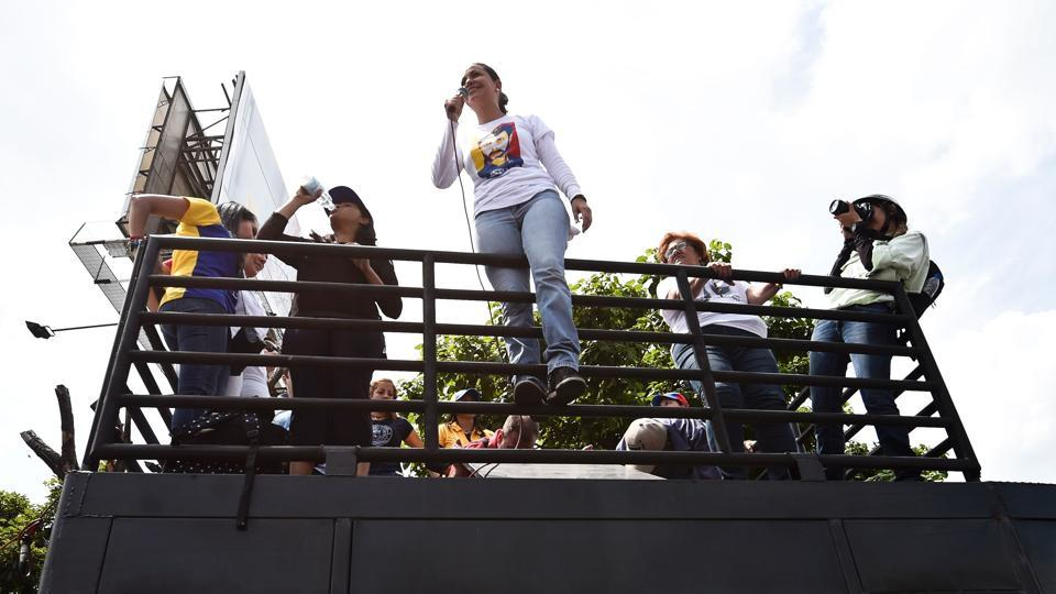 "Opposition ex-congresswoman Maria Corina Machado speaks to other demonstrators during the protest. The government and the opposition have traded blame for the deadly violence, with each side accusing the other of trying to mount a ""coup."" (Juan Barreto/AFP)"
