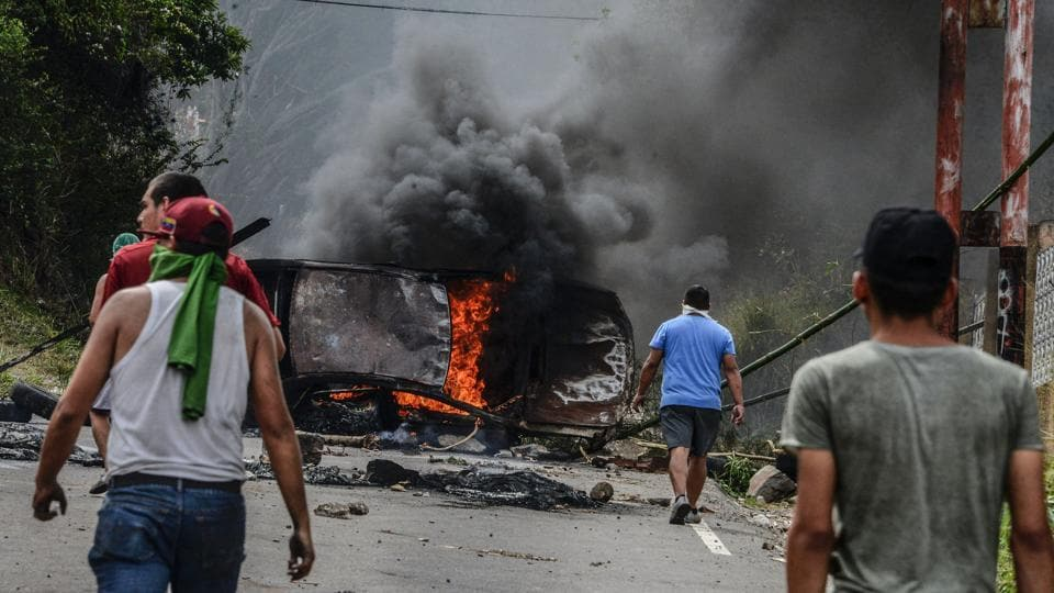 "Venezuelan opposition activists set up barricades during a demonstration in San Cristobal. Elections for regional governors due in December have been postponed. Maduro said Sunday he wanted the regional elections ""now"" but did not indicate a possible date for those or local ballots that are due this year. (George Castellanos/AFP)"