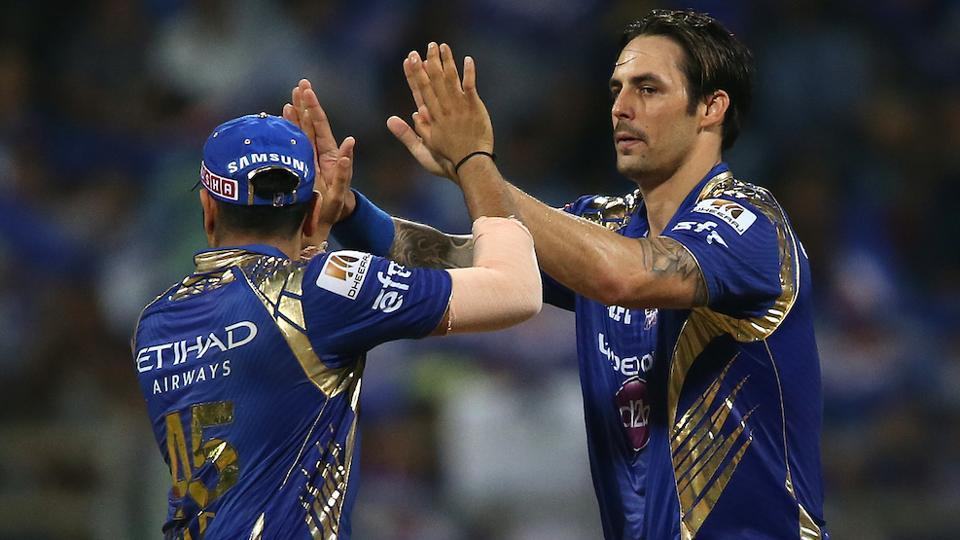 Mumbai Indians captain Rohit Sharma congratulates Mitchell Johnson after the dismissal of Ben Stokes. (BCCI)