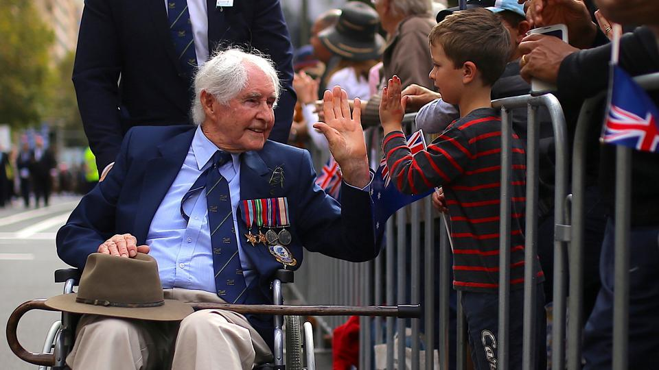A boy greets a veteran in a wheelchair during the annual ANZAC Day march. Gallipoli was the first time that soldiers from Australia and New Zealand fought under their own flags and is seared in the national consciousness as a point where their nations came of age, emerging from the shadow of the British Empire. (Steven Saphore/REUTERS)