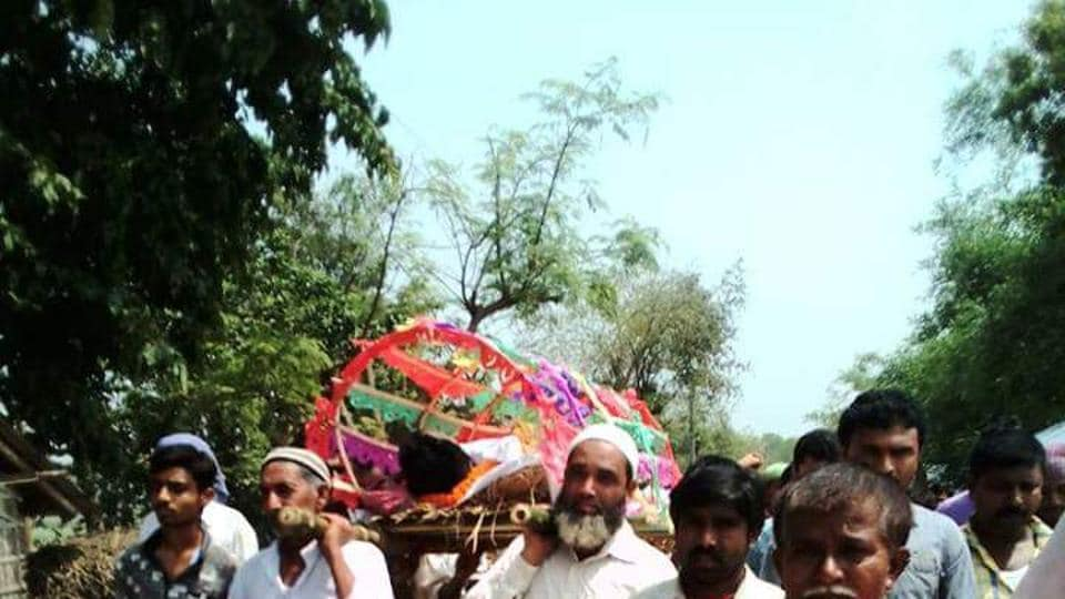 Muslim neighbours of Biswajit Rajak carrying his body to the crematorium in Malda on Tuesday.