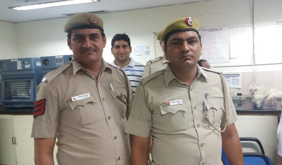 Delhi Police ASI Ramashray (L) and constable Ashok Kumar at  Dr Babasaheb Ambedkar Hospital in Rohini after donating blood.