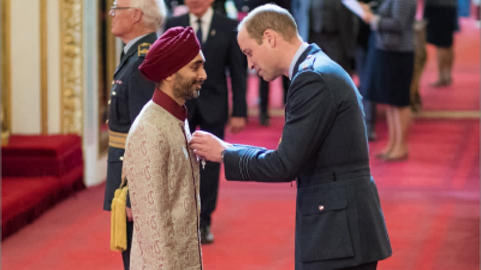 Jasvir Singh received the Order of the British Empire from Prince William at Buckingham Palace in London.