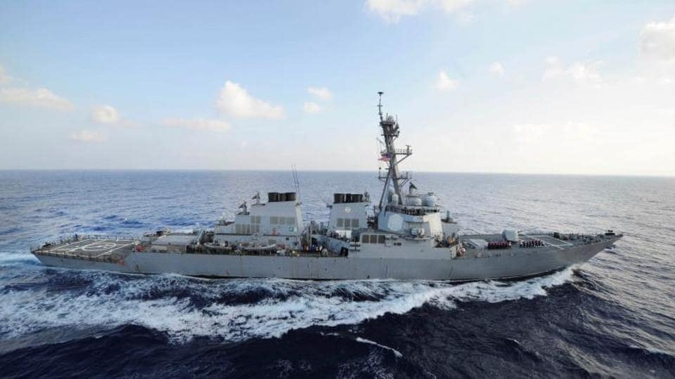 The US Navy says a guided-missile destroyer fired a flare toward an Iranian Revolutionary Guard vessel in a tense encounter in the Persian Gulf.