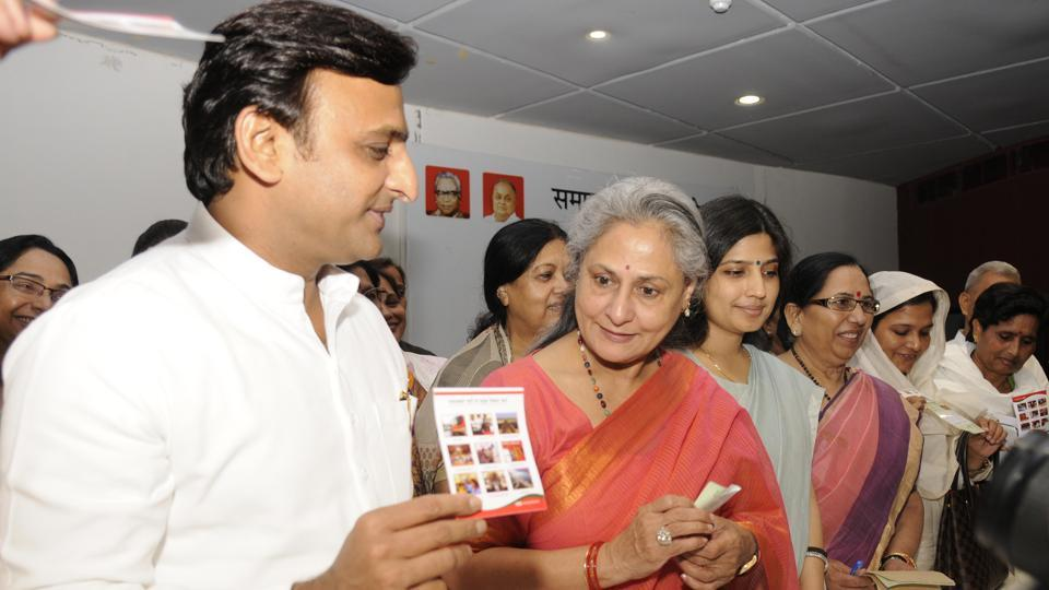 SP chief Akhilesh Yadav showing party's membership slip to Rajya Sabha member Jaya Bachchan at the party office in Lucknow.