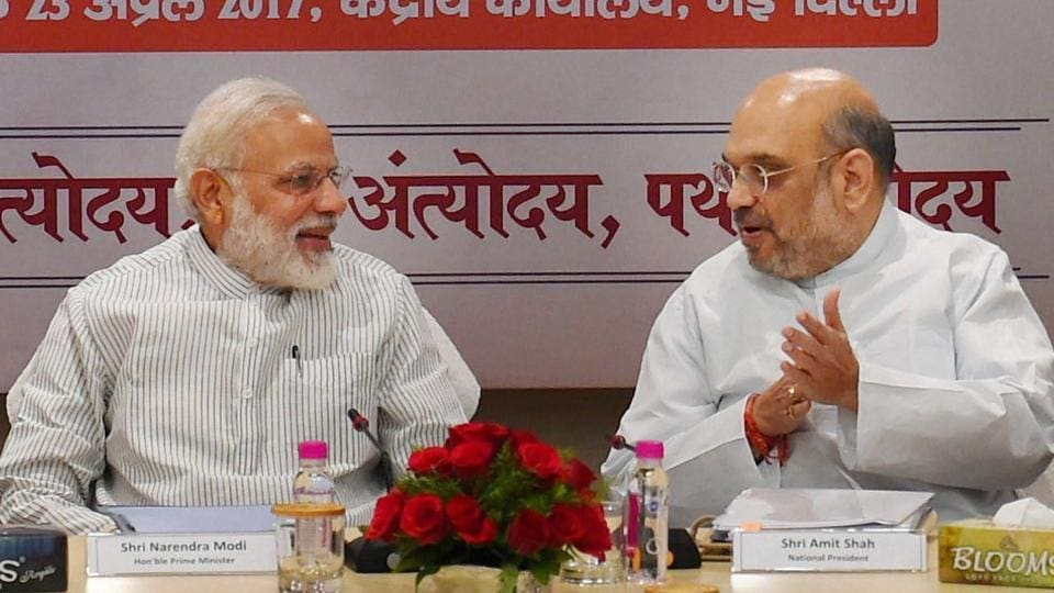 Prime Minister Narendra Modi with BJP President Amit Shah during a meeting with BJP chief ministers at party office in New Delhi on Sunday.