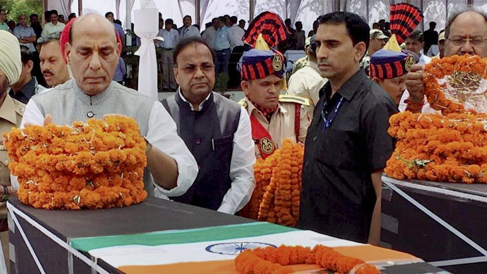 Union home minister Rajnath Singh pays tribute to CRPF jawans killed in a Maoist attack in Chhattisgarh's Sukma district, in Raipur on Tuesday.