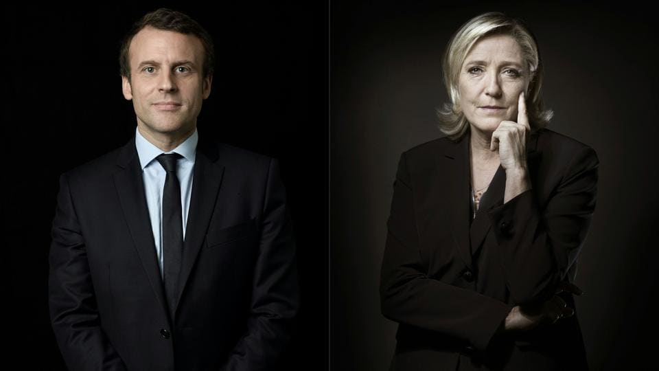 French presidential election candidate for the En Marche ! movement Emmanuel Macron (L) and candidate for the far-Right Front National (FN) party Marine Le Pen.