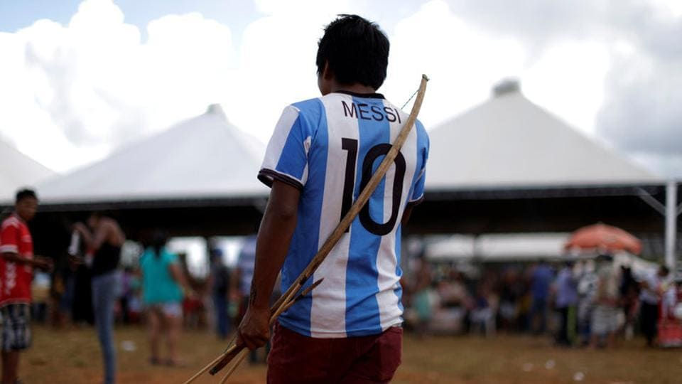 A Brazilian Indian seen wearing  Lionel Messi jersey as he takes part in a demonstration. (Ueslei Marcelino/REUTERS)