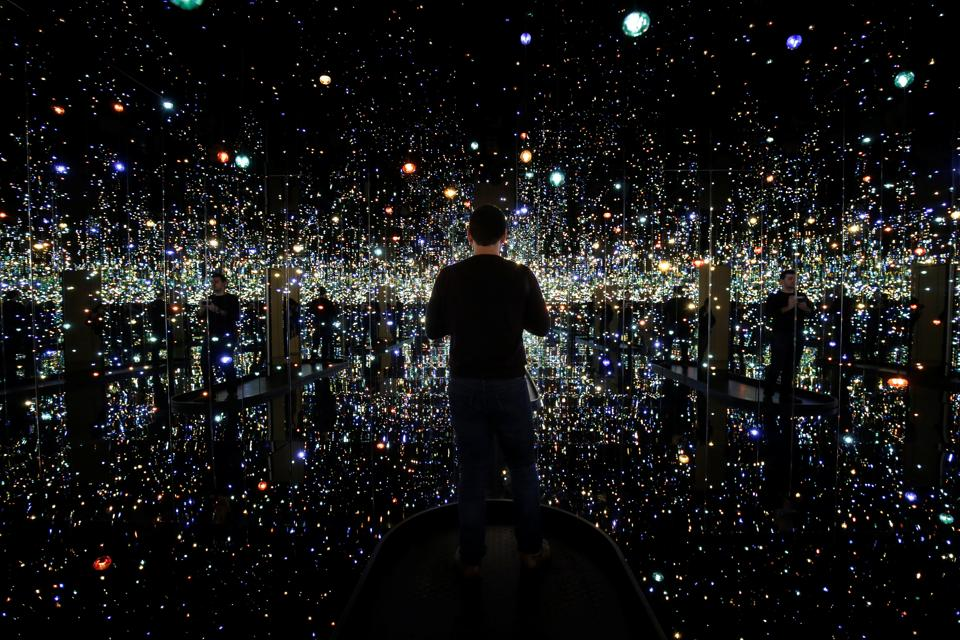 A man views the exhibit 'Infinity Mirrored Room - The Souls of a Million Light Years Away' by Japanese artist Yayoi Kusama at the Hirshhorn Museum in Washington, U.S. The artist is known for creating interactive optical illusions with vibrant colours and contrast leading to an unparalleled viewing experience for art lovers. (Joshua Roberts / Reuters)