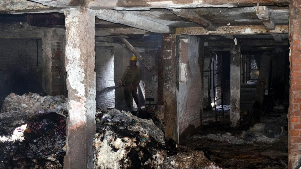A fire fighter dousing the fire in Ludhiana on Wednesday.
