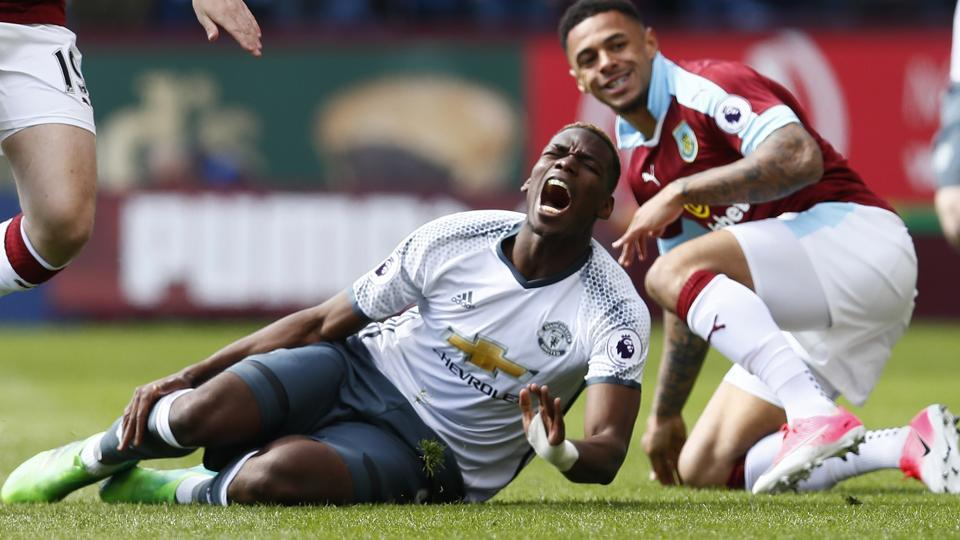 Manchester United's Paul Pogba is fouled by Burnley's Andre Gray during a Premier League match on April 23.
