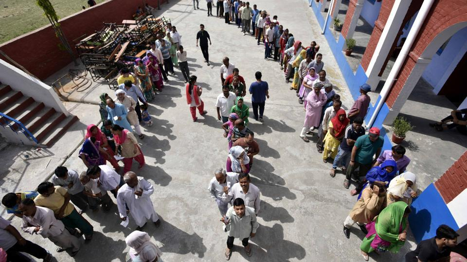 People waiting in queue at a polling booth to cast their vote for Municipal Corporation of Delhi polls at Burari, North Delhi on Sunday, April 23, 2017.