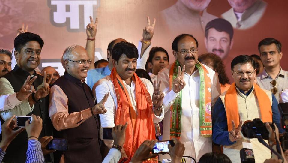 BJP Delhi president Manoj Tiwari and Union minister Venkaiah Naidu at the press conference at the BJP office in New Delhi on Wednesday after the MCD election results were announced.