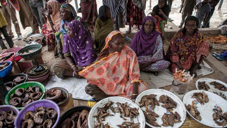 Women sell fish at a market in the town of Damasak . (Florian Plaucheur / AFP)