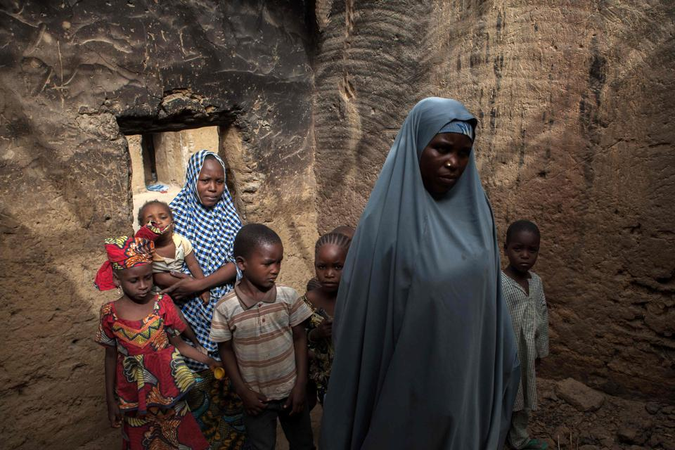 Yagana Bukar and her mother (R), whose two children have been kidnapped by Boko Haram insurgents, are seen at the family home in the town of Damasak in North East Nigeria . Yagana Bukar's younger brothers Mohammed and Sadiq were among about 300 children kidnapped by Boko Haram from the town of Damasak in remote northeastern Nigeria nearly three years ago who have returned to their homes.  (Florian Plaucheur / AFP)