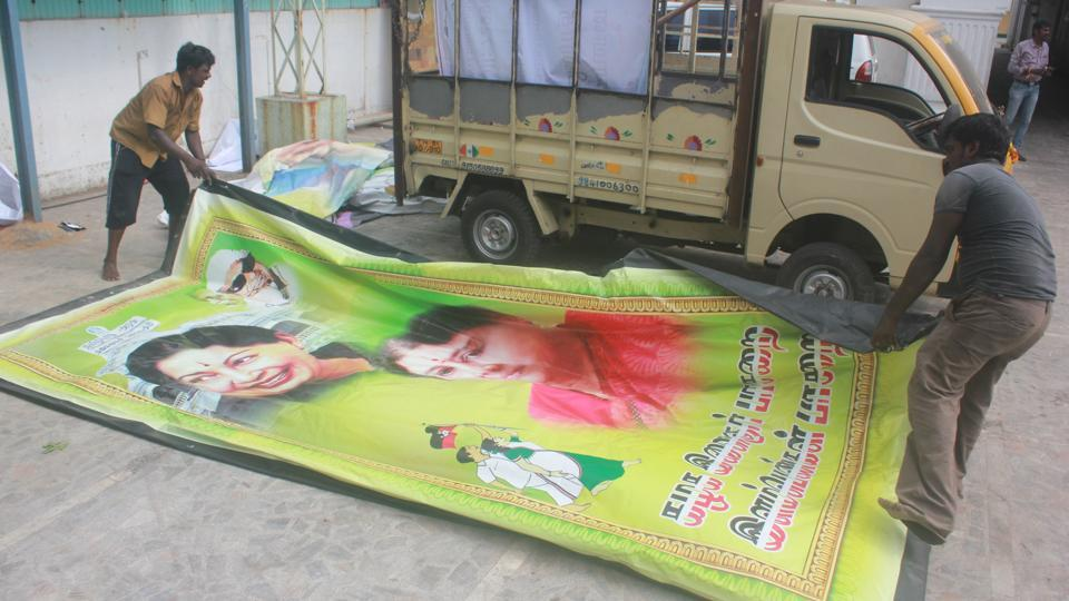 Workers remove posters and buntings featuring pictures of VKSasikala, the AIADMKgeneral secretary, from the party headquarters in Chennai on April 26, 2017.