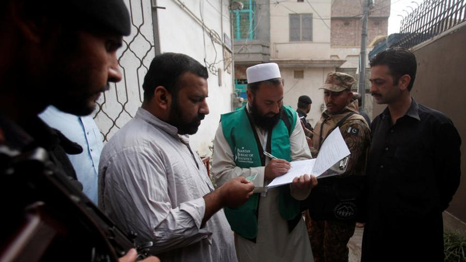A census enumerator notes details from a resident during Pakistan's 6th population census in Peshawar, Pakistan March 15, 2017.