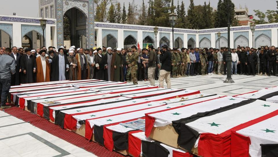 Syrian mourners attend a funeral ceremony in the Sayyida Zeinab mosque on the outskirts of Damascus on April 26, 2017, for the victims of a bombing that targeted buses carrying evacuees from the besieged government-held towns of Fuaa and Kafraya.