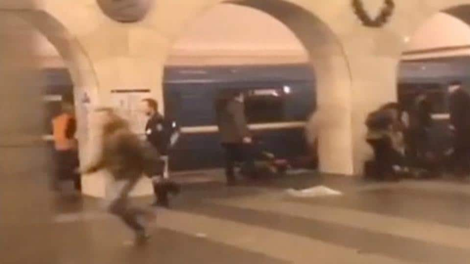A still image shows a man running past blast victims lying on a platform at the metro station in St. Petersburg on April 3.