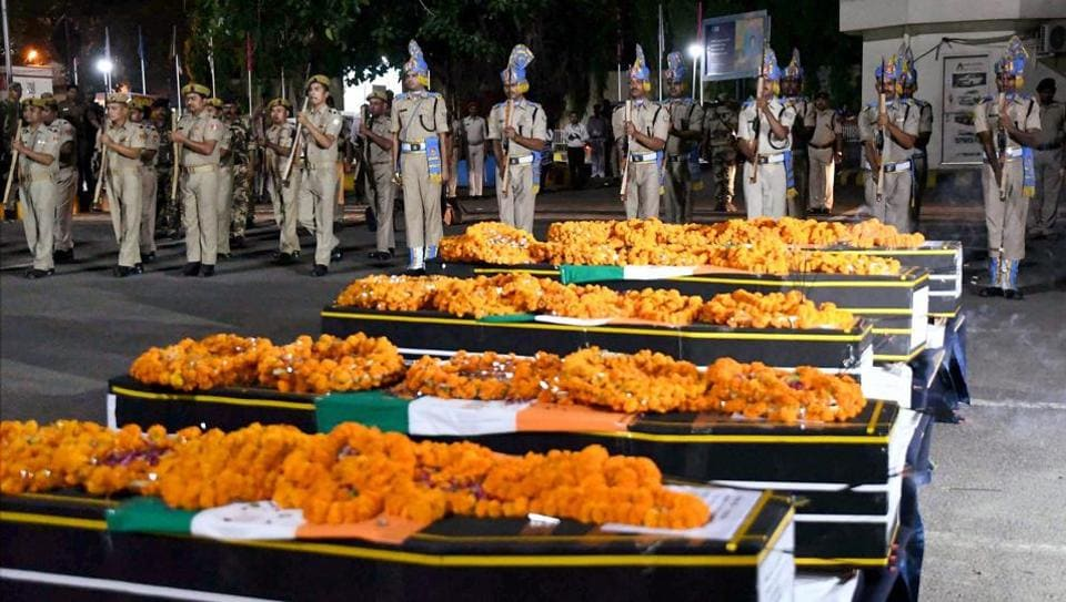 Jawans at Patna airport give a gun salute to CRPF personnel killed by Maoists in Sukma district on Monday.