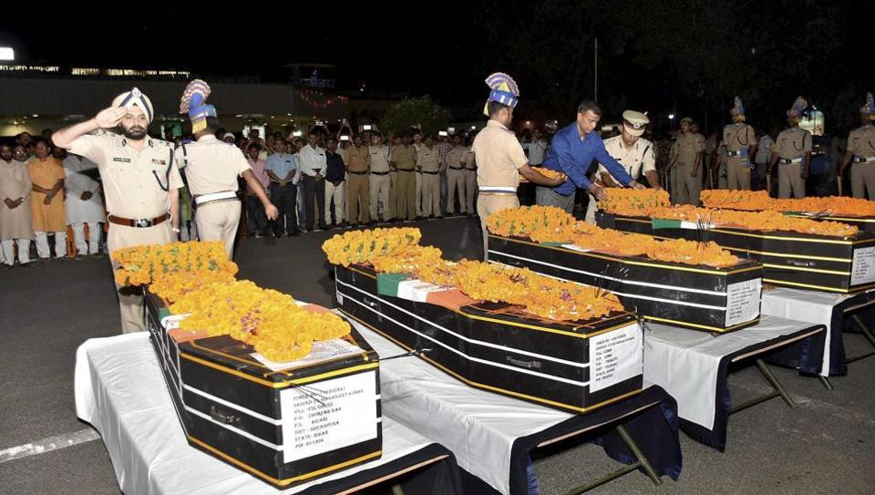 CRPF officers pay tributes to slain jawans who were killed in a Maoist attack in Chhattisgarh's Sukma district.