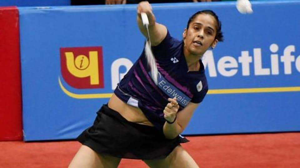 Saina Nehwal crashed out in the first round of the Asian badminton Championship, losing to Japan's Sayaka Sato.
