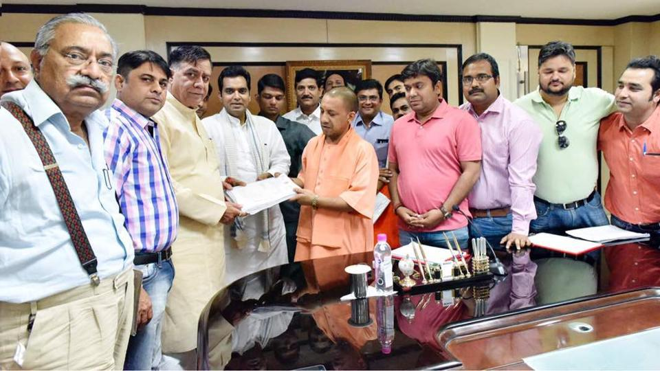 Noida homebuyers with UP CM  minister Yogi Adityanath
