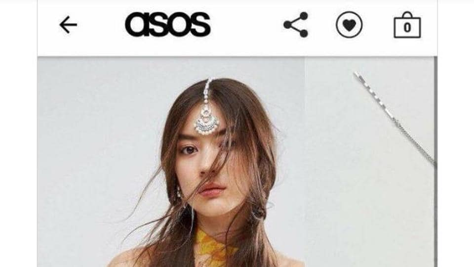 """A clip from the website showcased the maang-tika and called it """"chandelier hair-clips""""."""