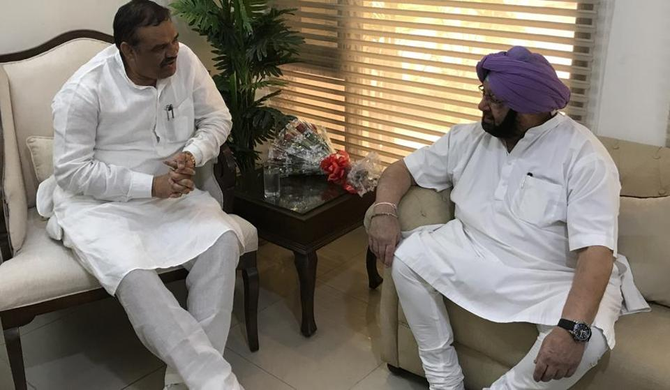 Punjab BJP chief Vijay Sampla with CM Capt Amarinder Singh in Chandigarh on Thursday.