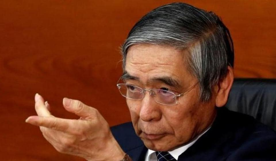 Bank of Japan (BOJ) Governor Haruhiko Kuroda gestures during a news conference.
