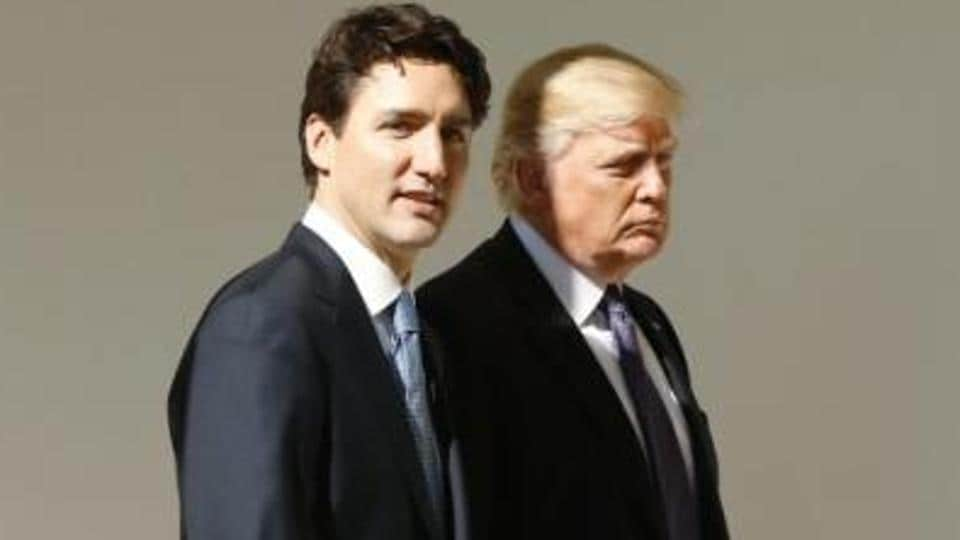 Canadian Prime Minister Justin Trudeau (L) walks down the West Wing colonnade with U.S. President Donald Trump at the White House in Washington, US.