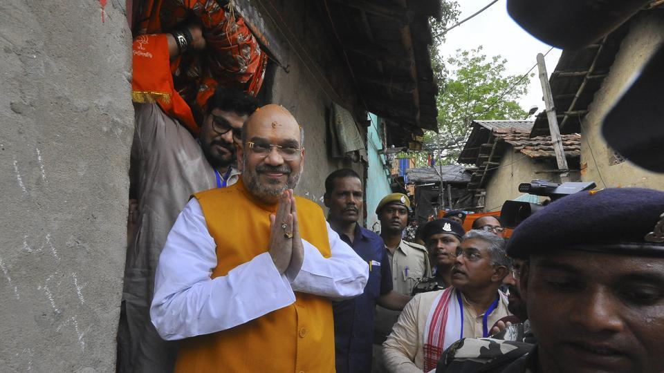BJP president Amit Shah at the residence of a slum dweller in Chetla in Bhawanipore Assembly constituency on Wednesday. Among the BJP leaders accompanying him were Babul Supriyo, Dilip Ghosh, Kailash Vijayvargiya and Rahul Sinha.